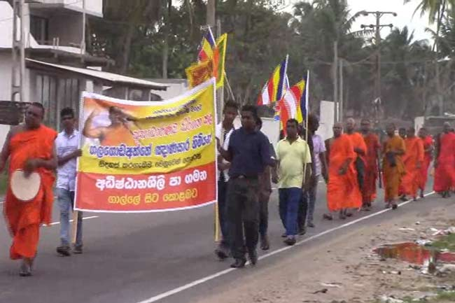 1529386360-monk-protest