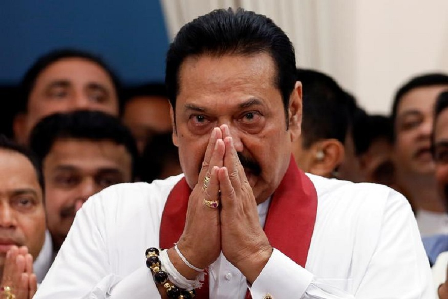 Sri Lanka's newly appointed Prime Minister Mahinda Rajapaksa gestures during the ceremony to assume duties at the Prime Minister office in Colombo, Sri Lanka October 29, 2018. REUTERS/Dinuka Liyanawatte